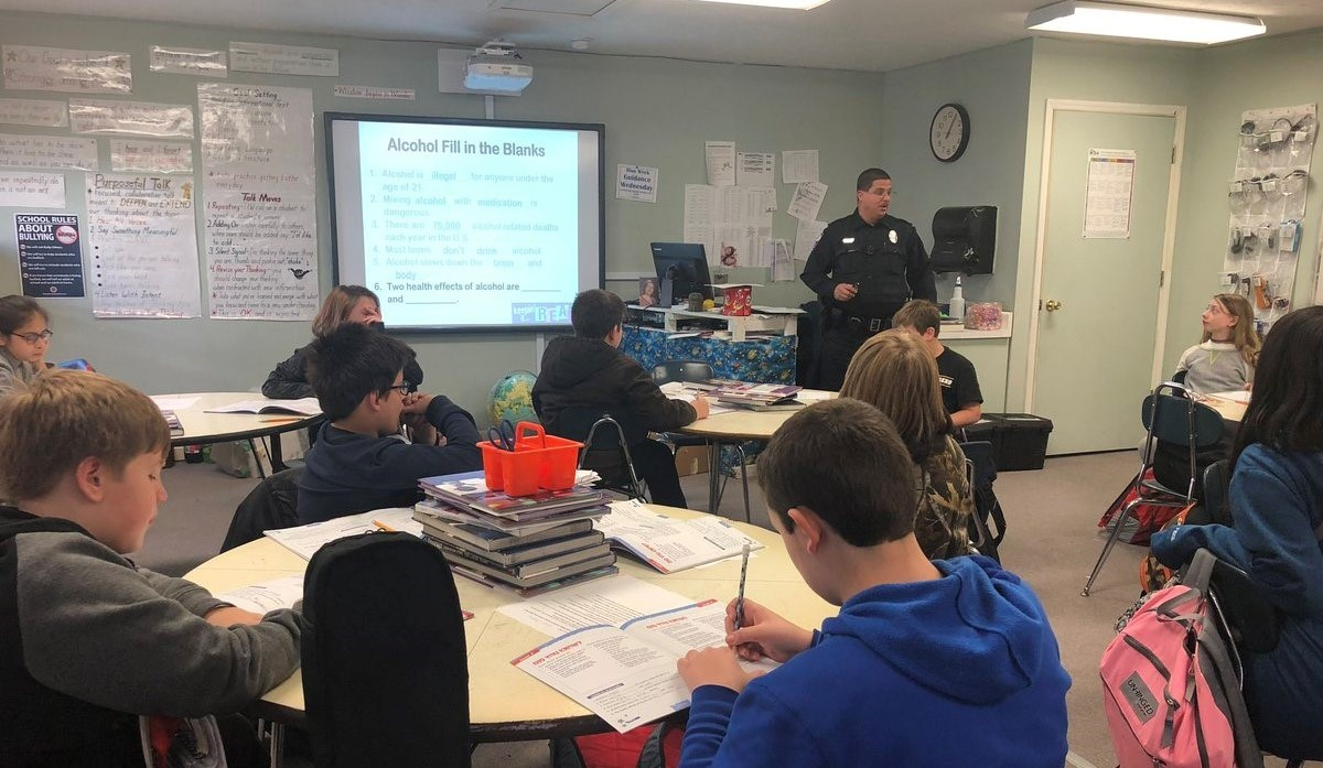 Dare officer teaches fifth graders about the importance of not abusing alcohol and drugs.